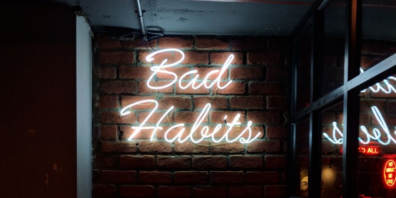 "Neon ""Bad Habits"" sign relating to depletion of collagen"