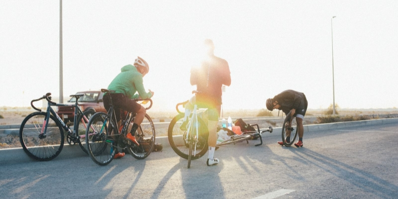 Three men riding bicycles on the freeway